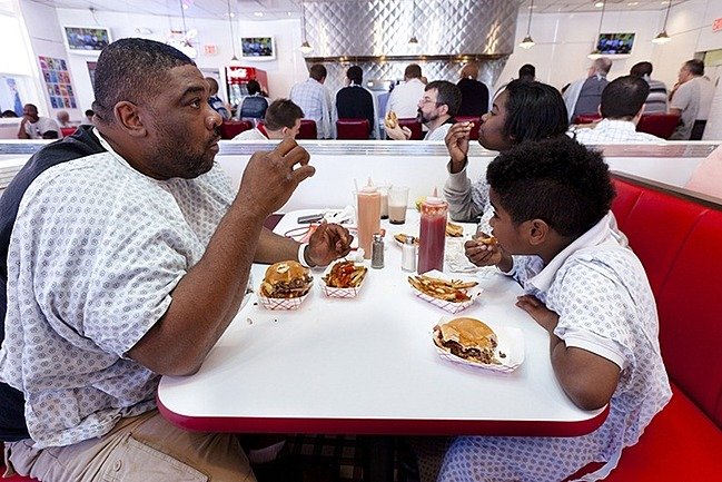 Customers-in-Cafe-eating-heart-attack-grill